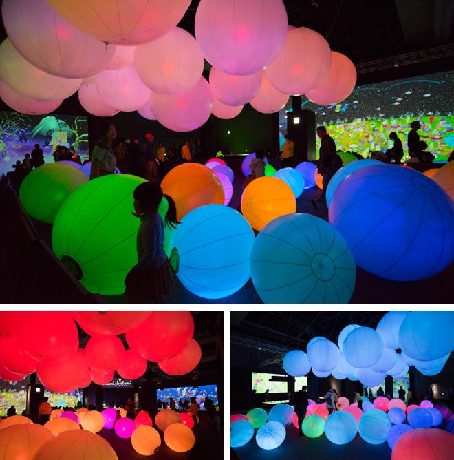 「光のボールでオーケストラ」 叩くと色が変わったり音が鳴ったりする、光のボールによるオーケストラ。大きいボールを叩くと周囲のボールも色が変わり、空間全体の色も変わる。子どもたちはさまざまなボールに触ることで、空間内の色を変化させながら音楽を自由に奏でる。