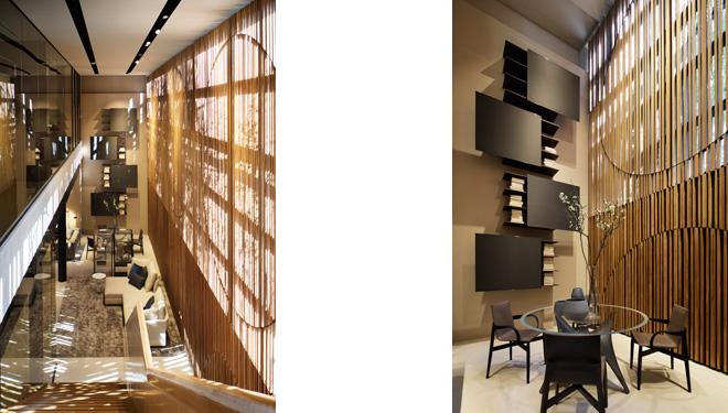 約100坪の広々とした店内は、地下と1階の2フロア構成。広いガラス面から陽光が差し込む1階までの吹き抜けには、壁面いっぱいに杉材の装飾が施されている。